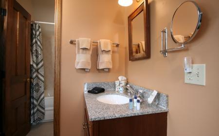 Vanity area and spa tub